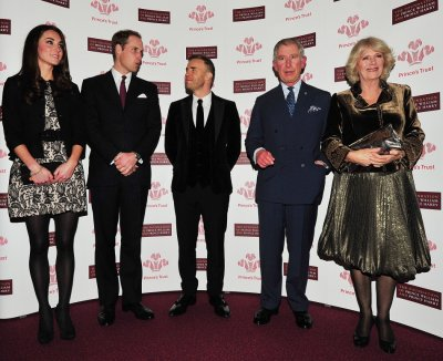 Britains Prince William and Kate Middleton, Duchess of Cambridge pose with singer Gary Barlow, Prince Charles and Camilla, Duchess of Cornwall ahead of a fund-raising concert at the Royal Albert Hall in London.