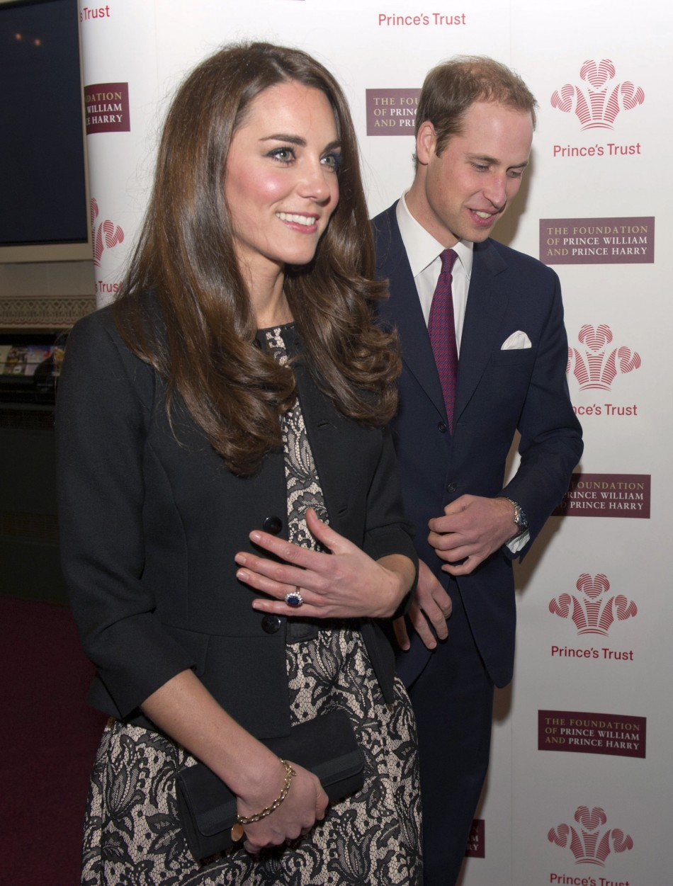Britain's Prince William and Kate Middleton, Duchess of Cambridge (L) Arrive at a fund-raising concert at the Royal Albert Hall in London December 6, 2011.