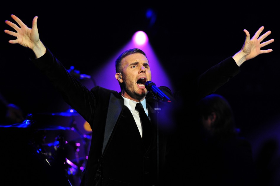 Singer Gary Barlow performs at a fund-raising concert in front of royalty at the Royal Albert Hall in London December 6, 2011.