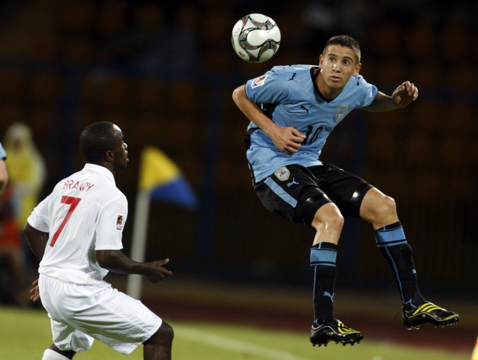Ramirez of Uruguay jumps for a high ball in front of Brandy of England during their FIFA U-20 World Cup soccer match in Ismailia