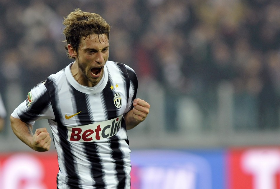 Juventus' Marchisio celebrates after scoring against Cesena during their Italian Serie A soccer match at the Arena stadium in Turin