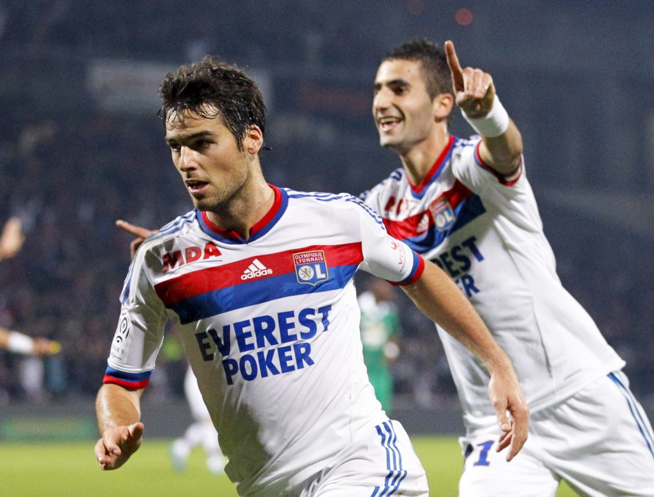 Olympique Lyon's Gourcuff and Gonalons celebrate after scoring against Saint-Etienne during their French Ligue 1 soccer match at the Gerland stadium in Lyon