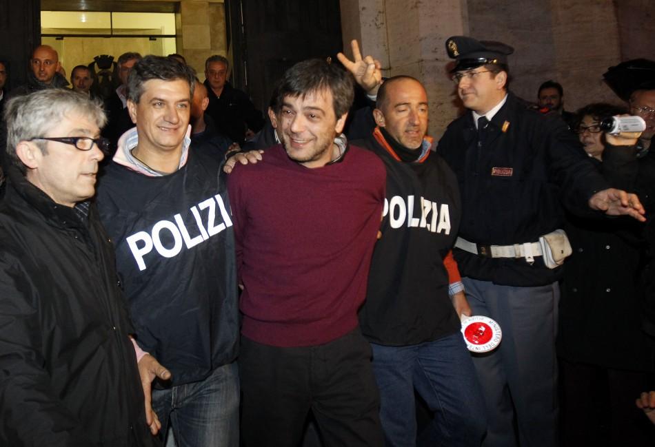 Italian policemen escort Camorra boss Antonio Iovine in 2010