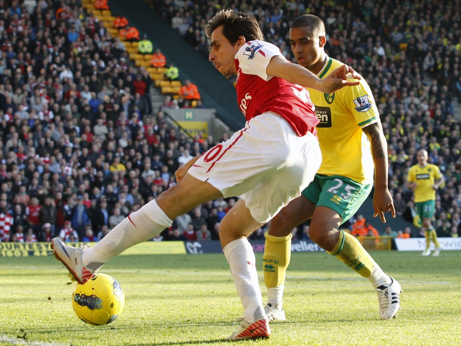 Norwich City's Naughton challenges Arsenal's Benayoun during their English Premier League soccer match at Carrow Road in Norwich