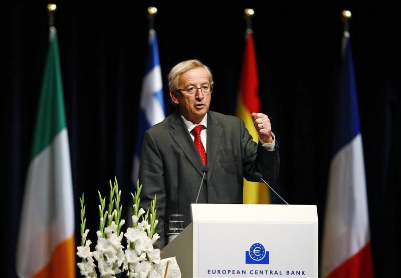 Chairman of the Euro group Junker delivers his speech during a farewell ceremony for outgoing head of ECB Trichet in Frankfurt