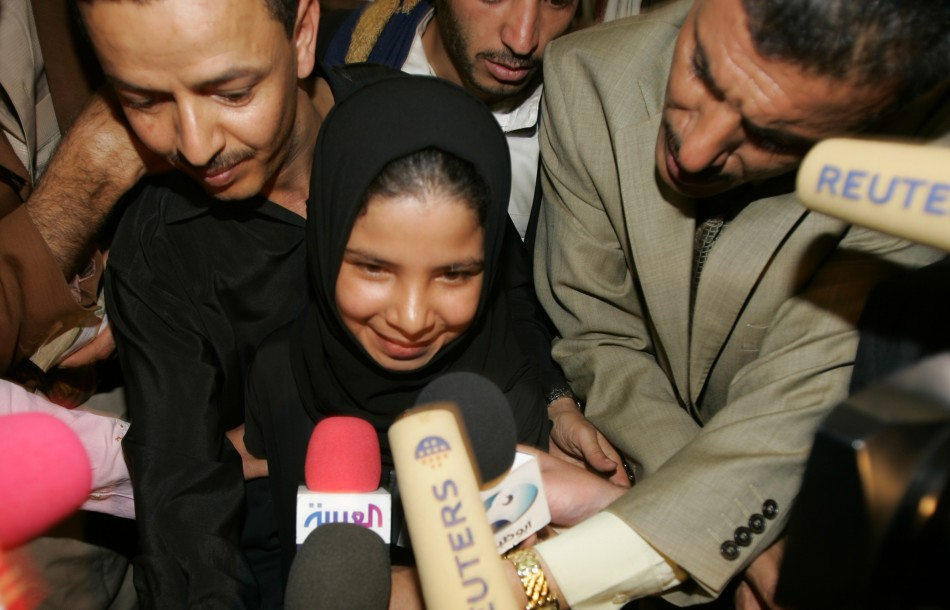 Nojood Muhammad Nasser, 9, talks to the media after she was granted divorce at a court in Sanaa