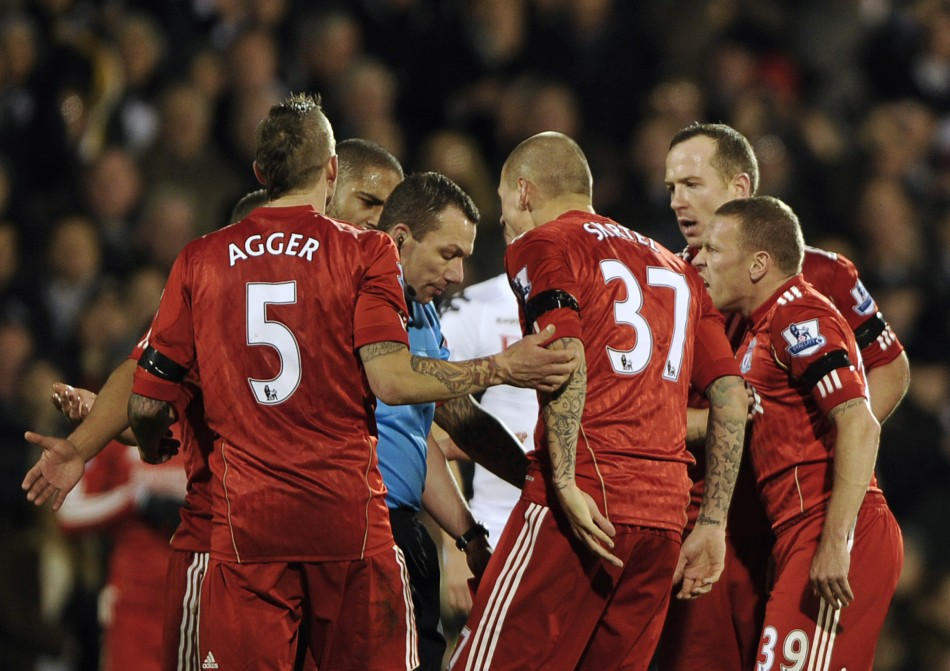 Liverpool players react as they surround referee Friend after he sent off Spearing for fouling Fulham's Dembele during their English Premier League soccer match at Craven Cottage in London