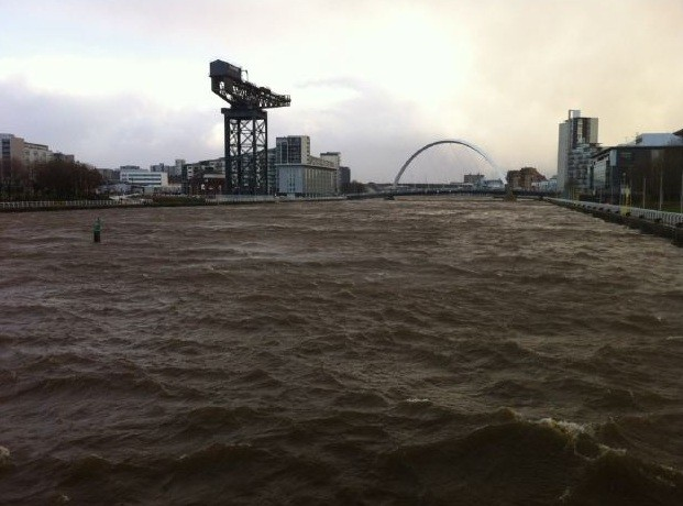 strong winds have caused the River Clyde in Glasgow to overflow and break its bank.