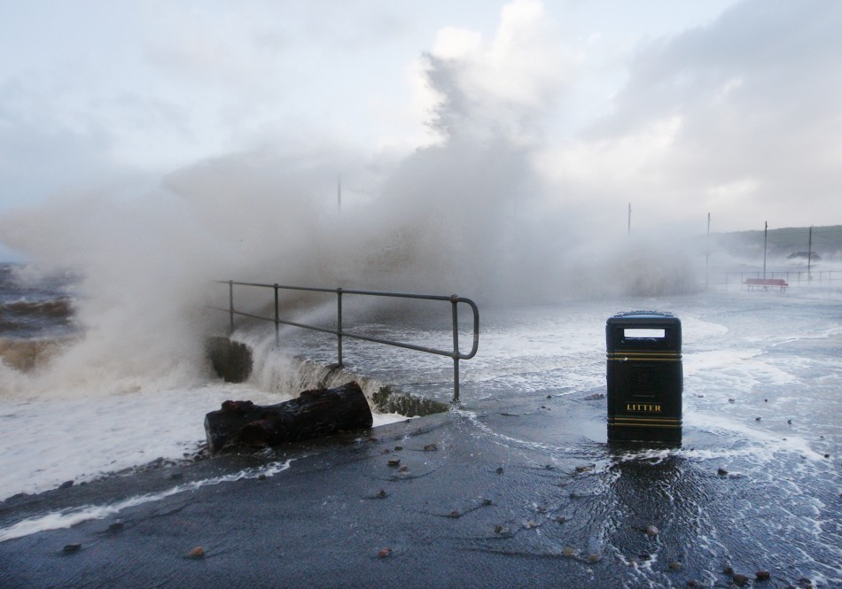 Waves crash against the promenade in Largs in west Scotland on Wednesday.