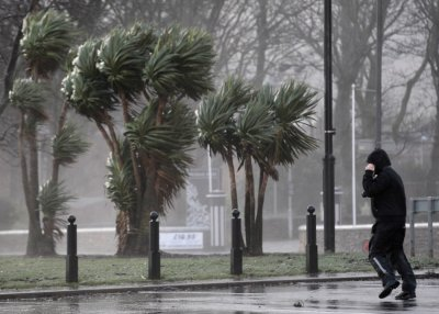 A man struggles against strong winds next to the promenade in Largs in west Scotland