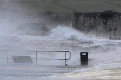 Waves crash against the promenade in Largs in west Scotland
