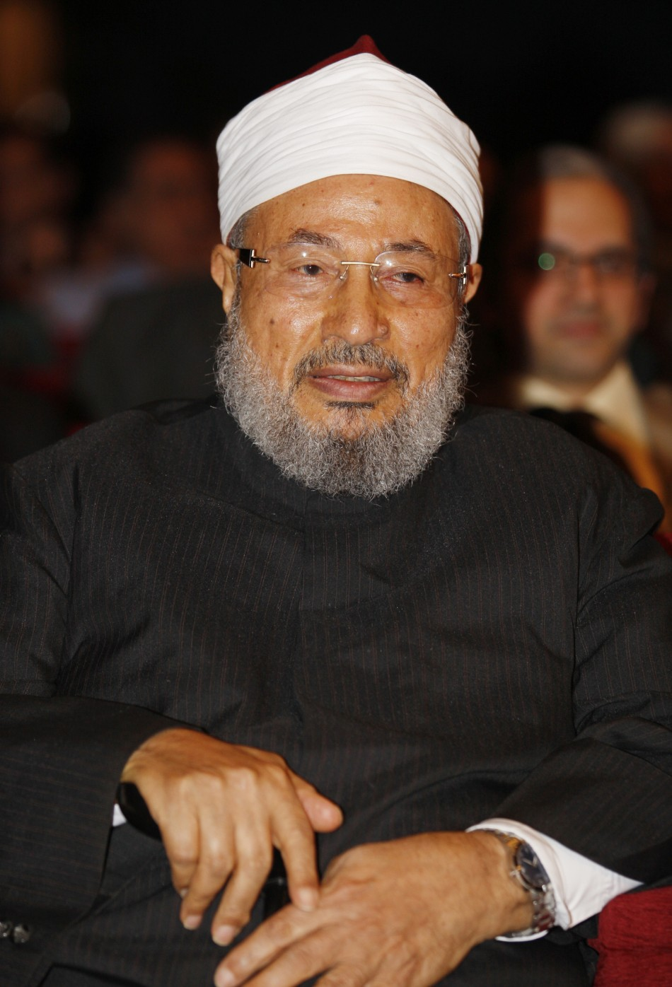 Egyptian-born cleric Sheikh Yussef al-Qaradawi attends a forum in Doha