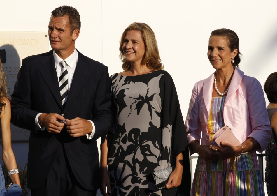 Spain's Inaki Urdangarin and his wife Infanta Cristina and the Infanta Elena arrive at Agios Nikolaos church to attend the wedding ceremony of Prince Nikolaos and Tatiana Blatnik on the island of Spetses