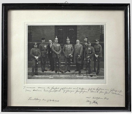 The photo shows Hitler with his eight fellow defendants standing on the court house steps. Six of the defendants have signed upon their respective images, including: Wilhelm Frick, Friedrich Weber, Hermann Kriebel, Erich Ludendorff, Wilhelm Bruckner and E