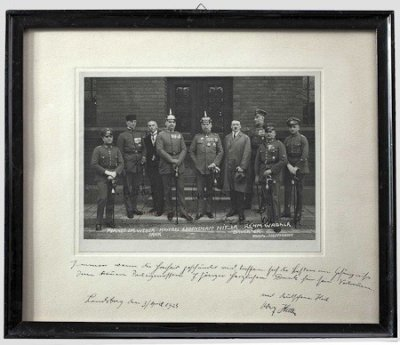The photo shows Hitler with his eight fellow defendants standing on the court house steps. Six of the defendants have signed upon their respective images, including Wilhelm Frick, Friedrich Weber, Hermann Kriebel, Erich Ludendorff, Wilhelm Bruckner and E