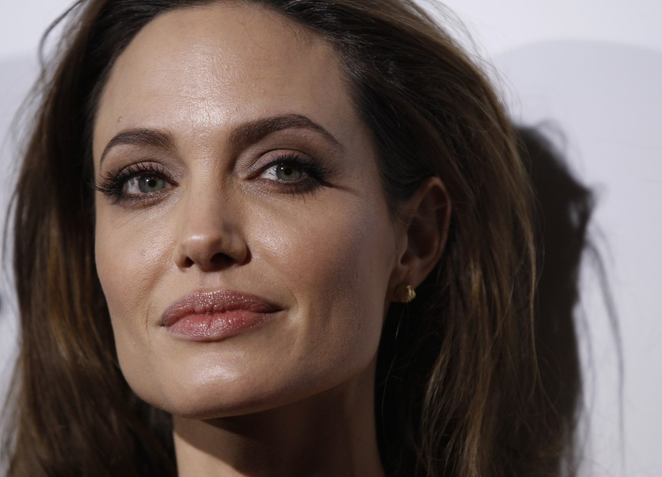 """Director of the movie Angelina Jolie poses at the premiere of """"In the Land of Blood and Honey"""" at the Arclight theatre in Los Angeles, California"""