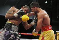 Lamont Peterson (L) and Amir Khan -December 10, 2011