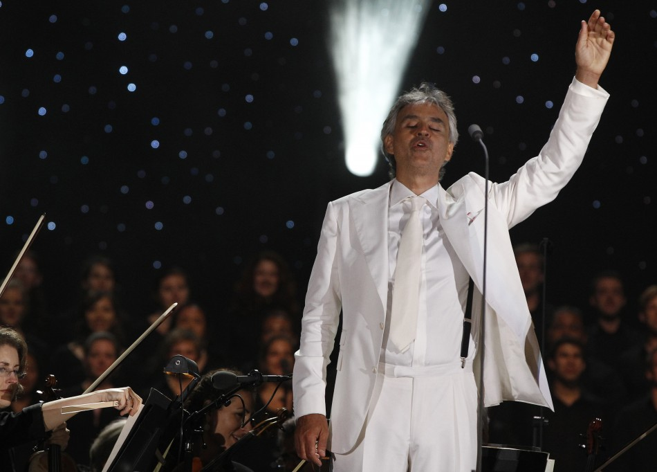 Italian tenor Bocelli waves to the crowd during his performance in New York