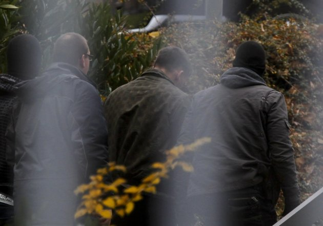 A suspected accomplice (C) of a neo-Nazi cell is escorted by police at the Bundesgerichtshof in Karlsruhe November