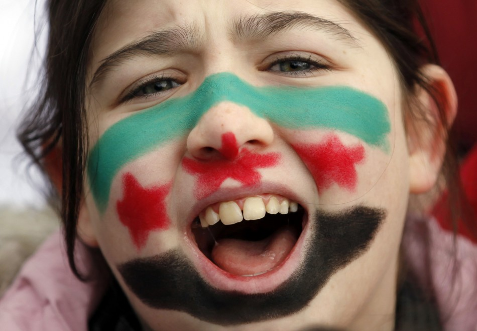 A Syrian girl living in Turkey shouts slogans as a group of Syrians protest against the government of Syria's President