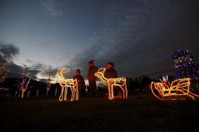 Children play with decorative raindeers at a country house estate in the village of Grabovnica near Cazma