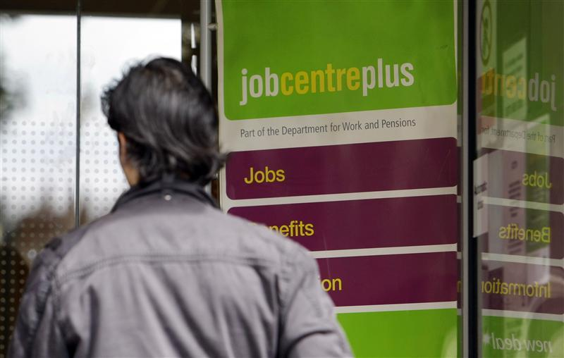 A man enters a Job Center in London
