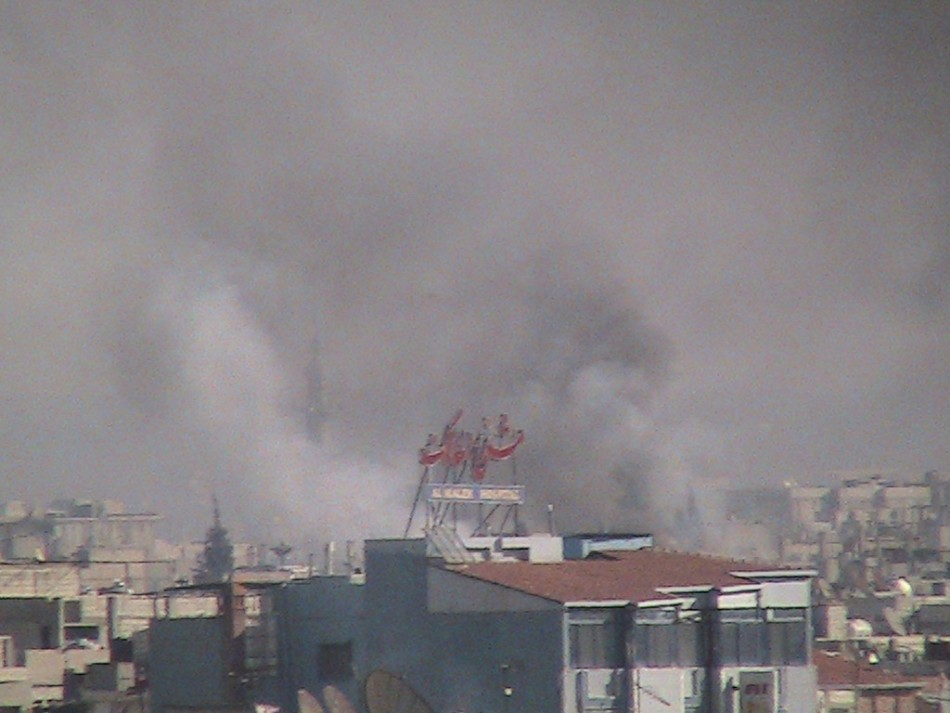 Smoke rises from the city of Homs