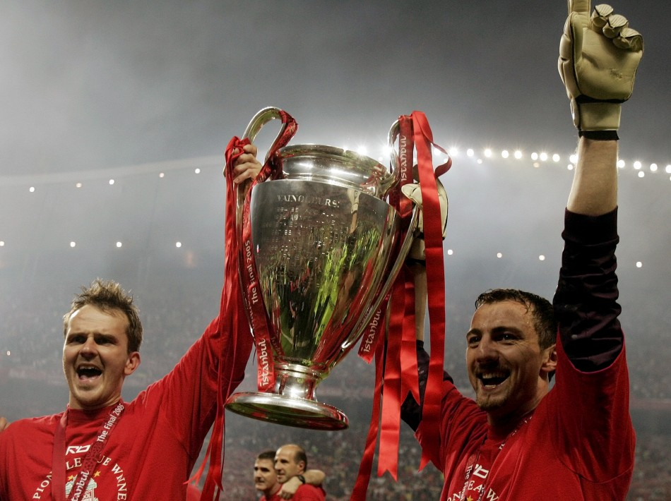 Liverpool's Jerzy Dudek and German midfielder Dietmar Hamann hold the trophy