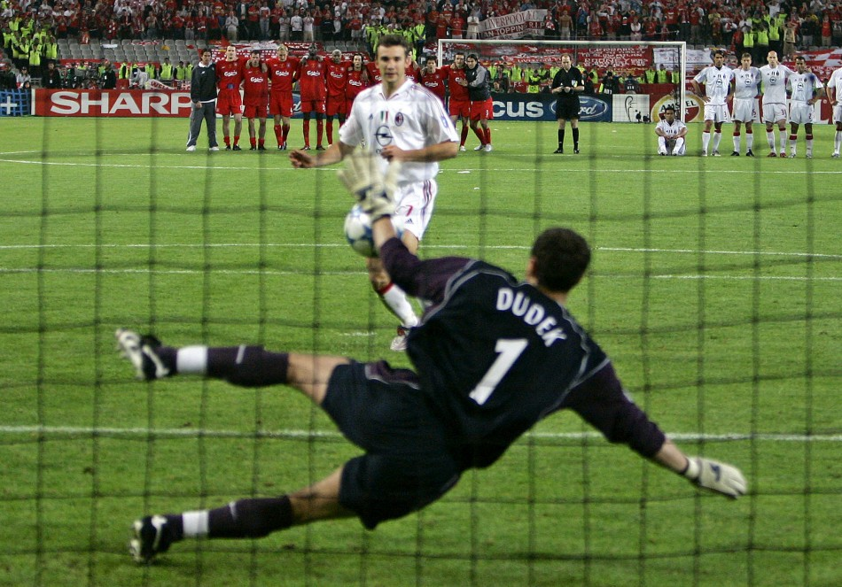 Liverpool's goalkeeper Dudek stops a penalty shot from AC Milan's Shevchenko during their Champions Final in 2005