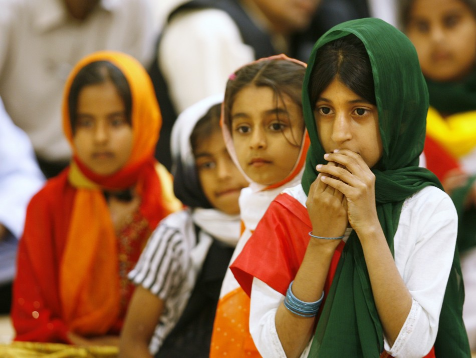 Children wait their turn to read the Koran with Head of Worldwide Ahmadiyya Muslim community Hadhrat Mirza Masroor Ahmad at the new Baitun Nur Mosque in Calgary