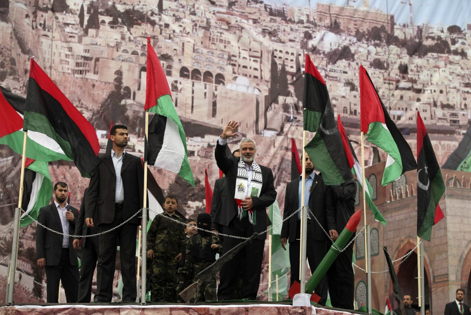 Senior Hamas leader Haniyeh waves upon his arrival at a rally in Gaza City