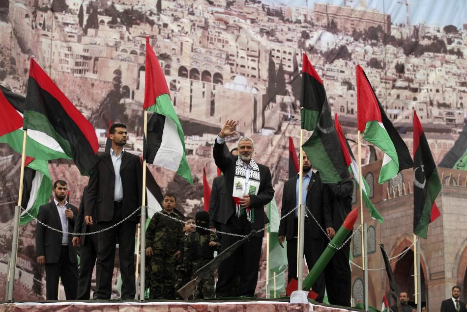 Senior Hamas leader Haniyeh waves upon his arrival at a rally in Gaza City