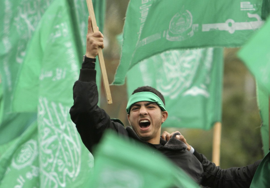 A Hamas supporter attends a rally in Gaza City