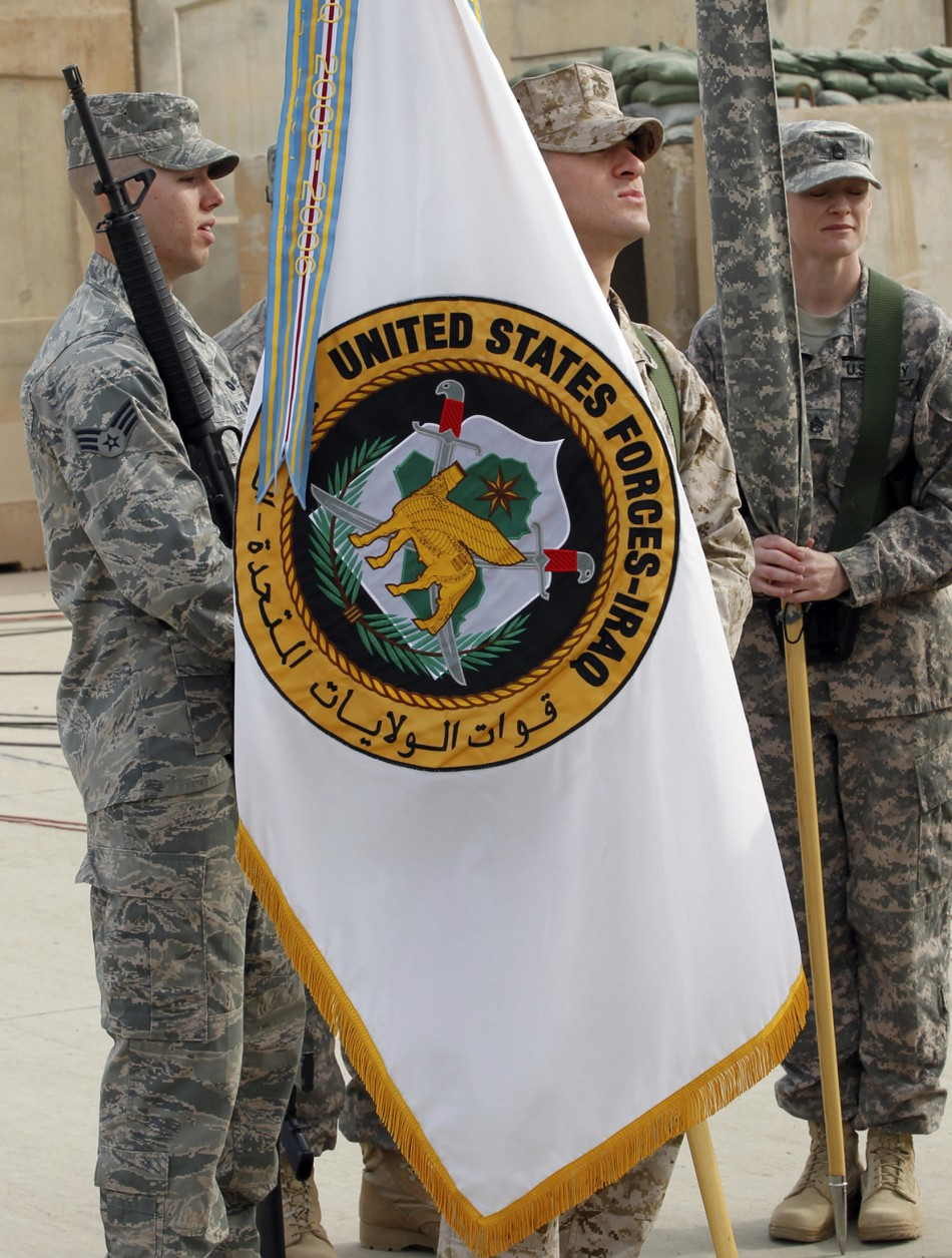 Commanding General of U.S. forces in Iraq, Lieutenant General Austin folds U.S. Forces in Iraq flag during ceremony marking end of U.S. military engagement at former U.S. Sather Air Base near Baghdad
