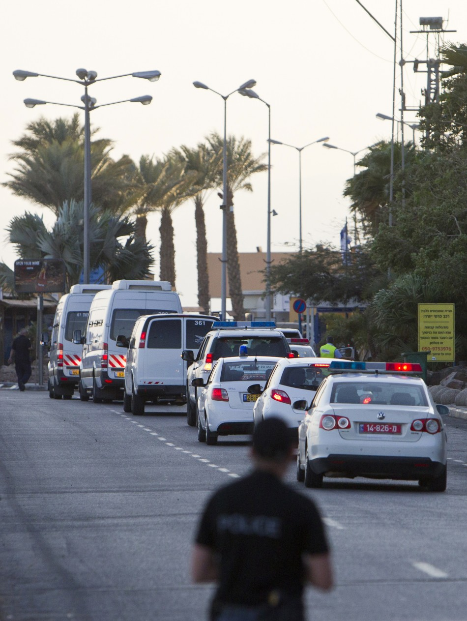 Israeli Prison Authority vehicles transporting Egyptian prisoners cross through the border crossing next to the Egyptian Red Sea resort of Taba