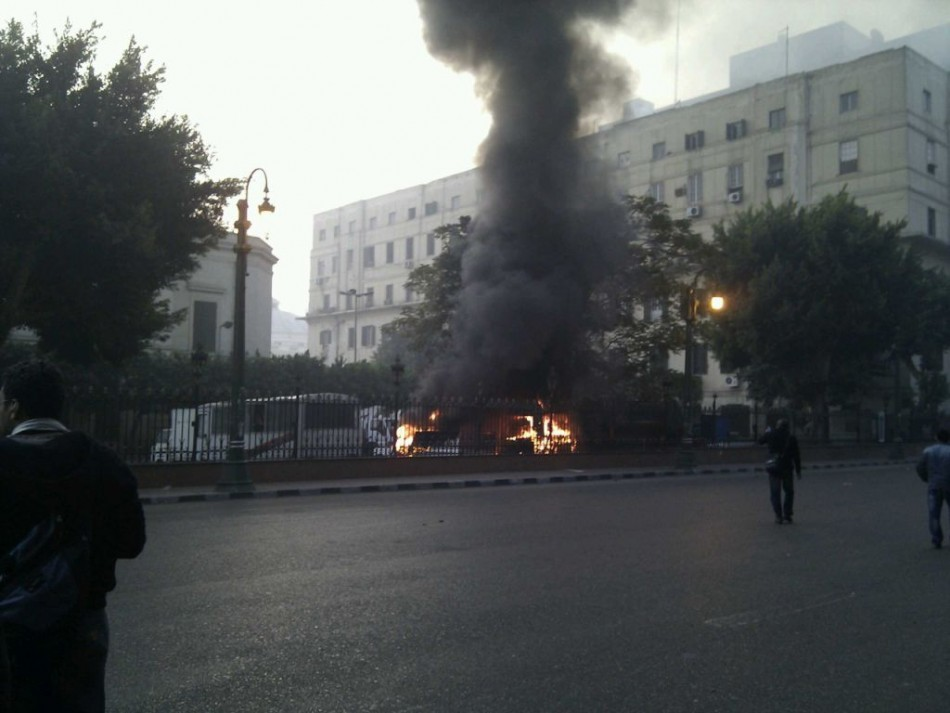 Cars are set on fire in front of the parliament's building