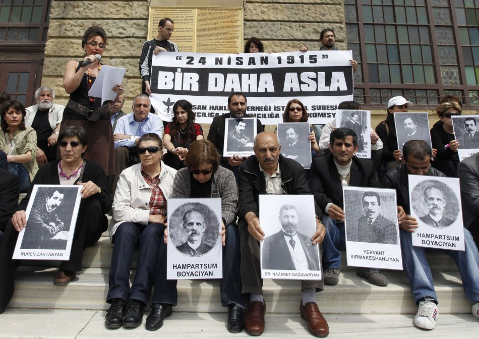 Human rights activists hold pictures of Armenian victims in front of the historical Haydarpasa station in Istanbul