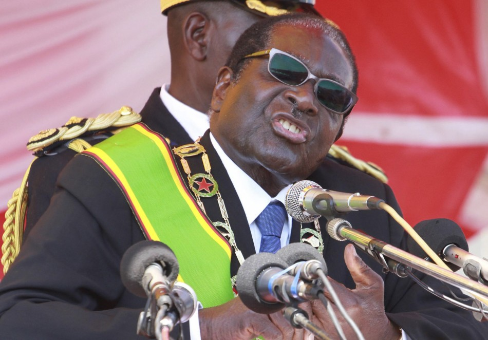 Zimbabwe's President Robert Mugabe addresses supporters at a Heroes Day rally in the capital Harare