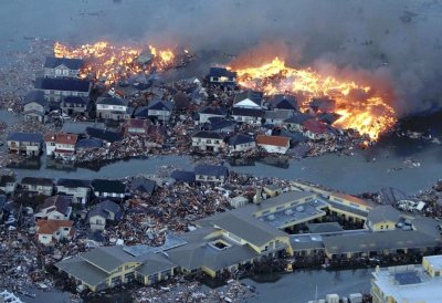 Houses swept out to sea burn