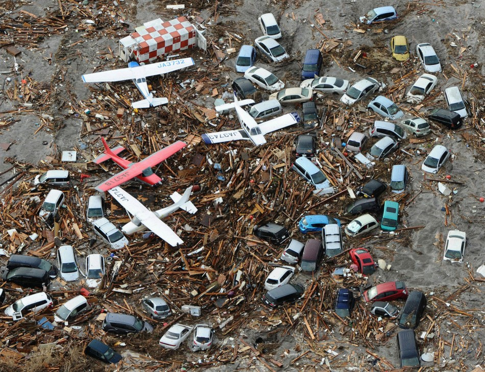 Cars and airplanes swept by a tsunami are pictured among debris at Sendai Airport, northeastern Japan March 11, 2011