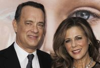 "Cast member Tom Hanks (L) and his wife Rita Wilson arrive for the premiere of the film ""Extremely Loud and Incredibly Close"" in New York"