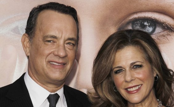 """Cast member Tom Hanks (L) and his wife Rita Wilson arrive for the premiere of the film """"Extremely Loud and Incredibly Close"""" in New York"""