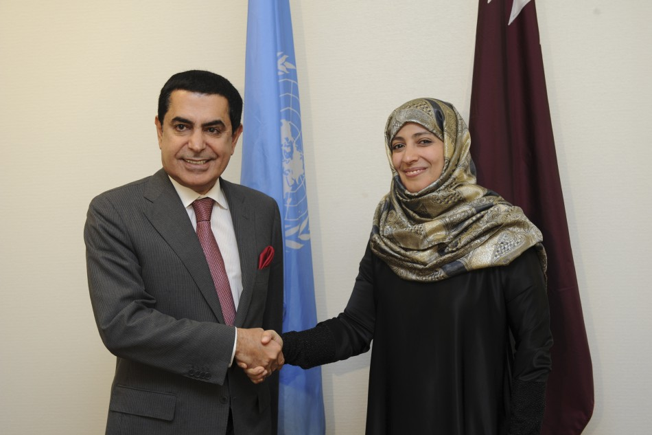 President of the UN General Assembly Al-Nasser shakes hands withTawakkol Karman, the first Arab woman to receive the Nobel Peace Prize