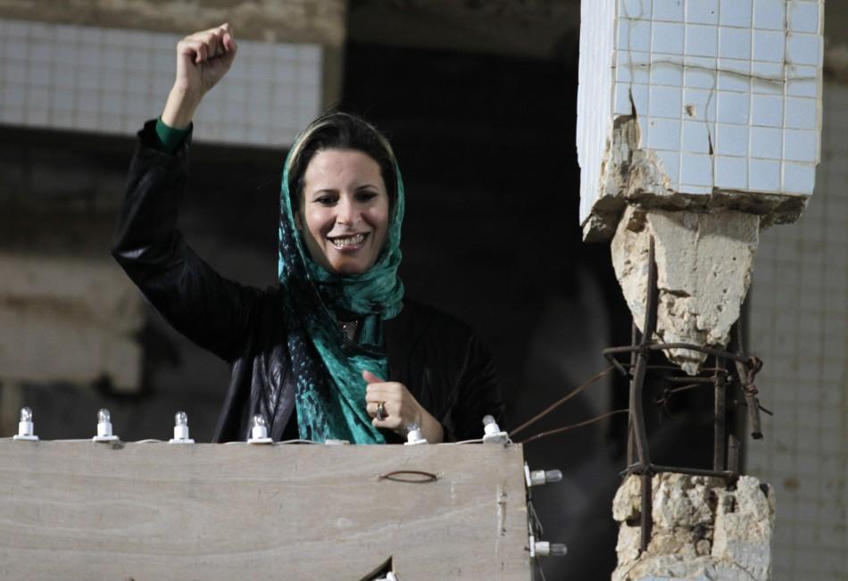 Aisha Gaddafi, daughter of Libyas leader Muammar Gaddafi,greets her fathers supporters