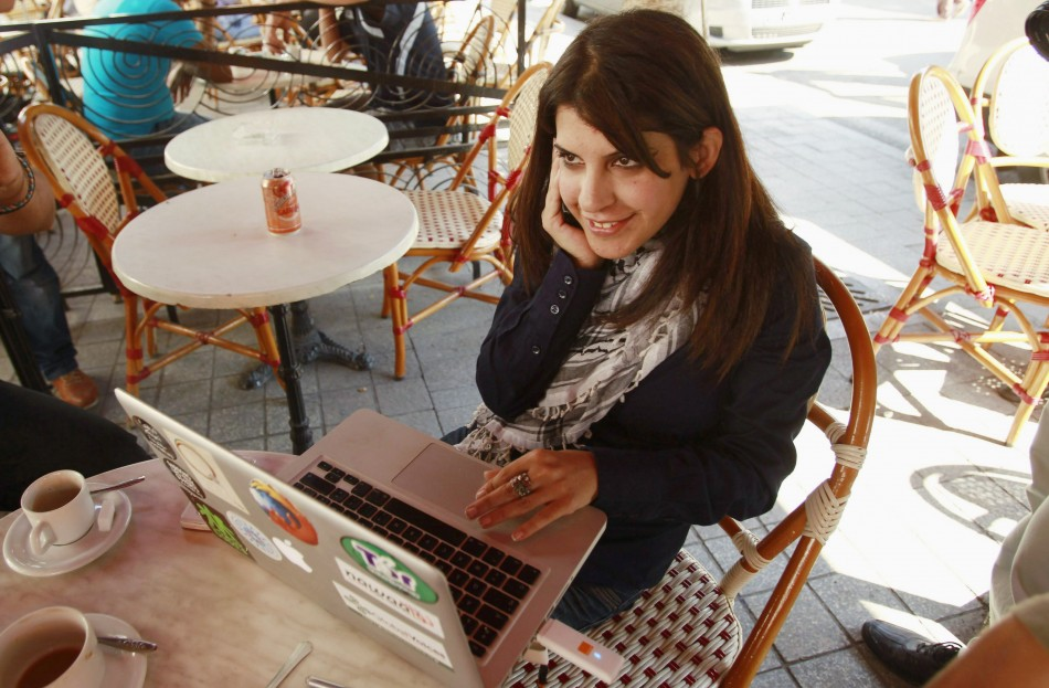 Tunisian blogger Lina Ben Mhenni, who has been tipped for the 2011 Nobel Peace Prize, works on her computer at a cafe in Tunis