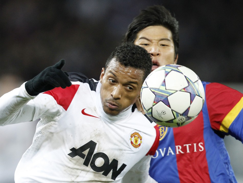 FC Basel's (FCB) Park Joo Ho (R) fights for the ball with Nani of Manchester United
