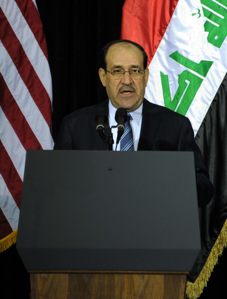 Iraq's PM al-Maliki speaks during one of several planned ceremonies to mark the end of American military presence in Iraq, in Baghdad