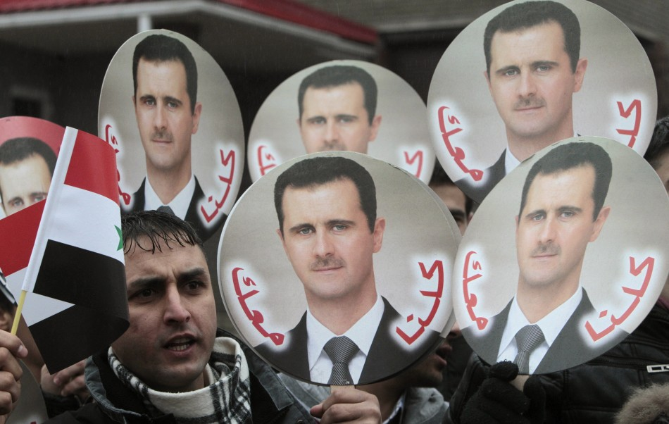 A Syrian citizen takes part in a rally in support of President Bashar al-Assad in front of the Syrian embassy in Minsk