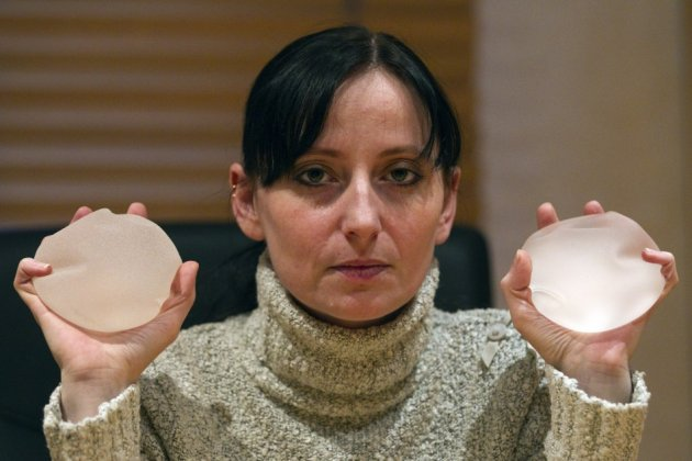 Alexandra Blachere holding breast implants