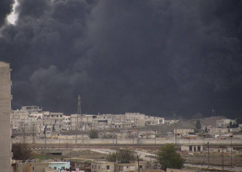 Black smoke is seen from Homs refinery